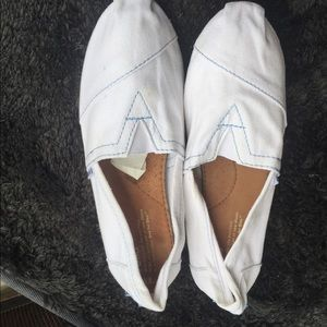 Toms off white with blue stitching